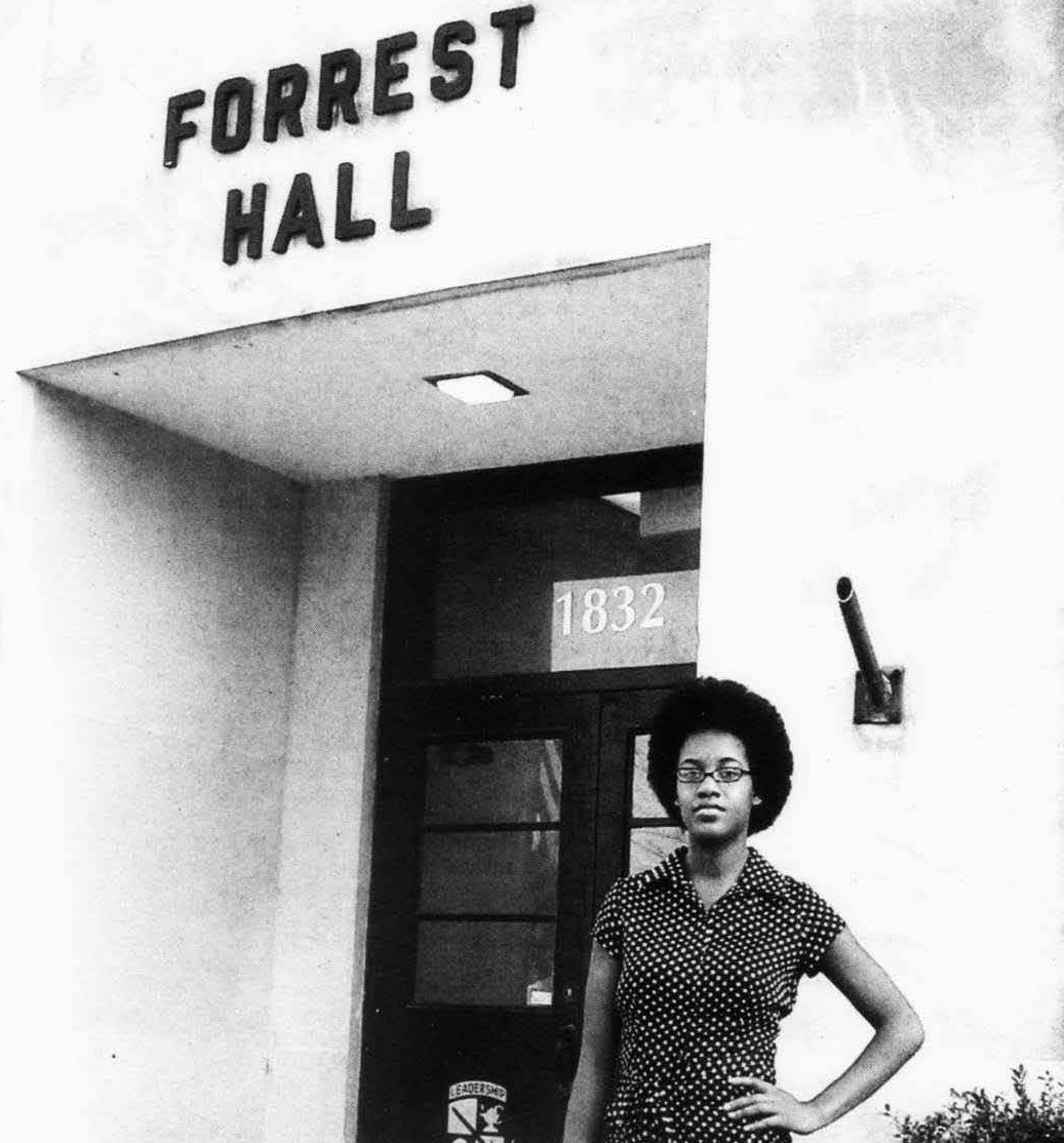 Amber Perkins standing in front of Forrest Hall