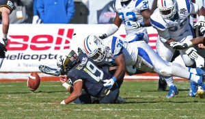 T.T. Barber, shown here forcing a fumble against Navy, was named the Blue Raiders' MVP of the Armed Forces Bowl by members of the media.